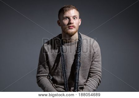 Portrait of young surprised man on gray background