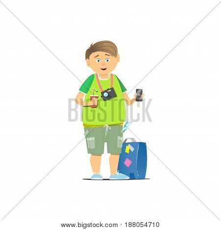 Young guy with phone in hand. A tourist in a green T-shirt and suitcase.