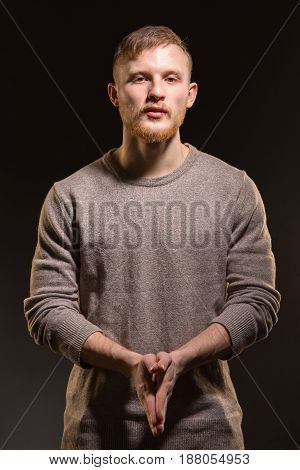 Portrait of young attractive man on black background