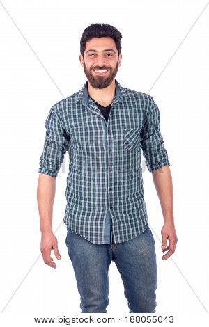 Portait of beard young man wearing green shirt and jeans isolated on white background