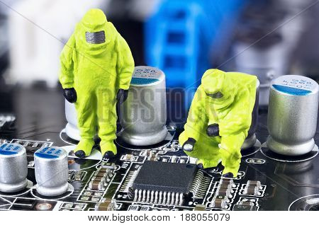 Two toy technicians are repairing and diagnosing a motherboard.