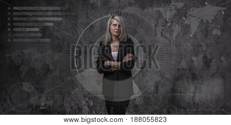 Confident business woman stands on a background of graphs and diagrams, blonde in a black jacket. Style