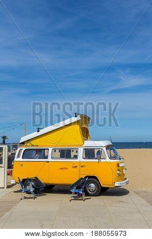 Scheveningen beach the Netherlands - May 21 2017: yellow VW combi camper wagen at Aircooled classic car show
