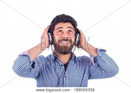 smiling yung man listening to music and looking up guy wearing blue shirt isolated on white background