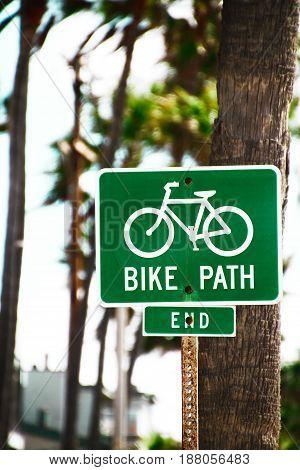 green bike lane symbol on public street