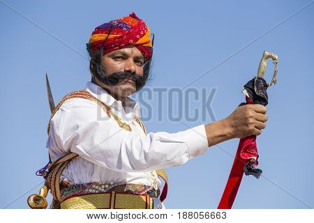 JAISALMER INDIA - FEBRUARY 09 2017 : Unidentified men wearing traditional Rajasthani dress participate in Mr. Desert contest as part of Desert Festival in Jaisalmer Rajasthan India. Close up