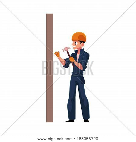 Worker, builder in helmet, overalls hammering nails into the wall, cartoon vector illustration isolated on white background. Full length portrait of Caucasian construction worker, builder with hammer