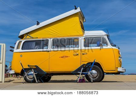 Scheveningen beach the Netherlands - May 21 2017: yellow VW combi camper wagen at Aircooled classic car show