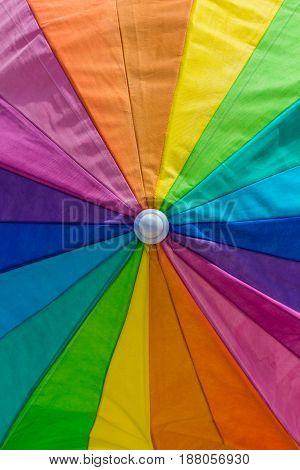 closeup of vibrant rainbow color beach umbrella