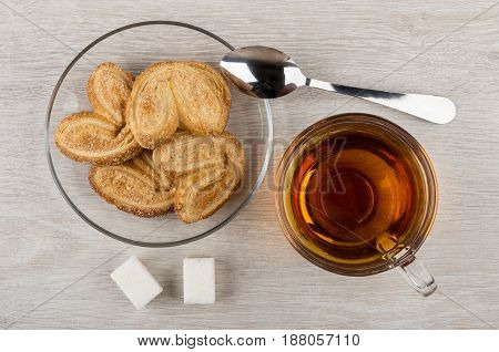 Puff Cookies In Saucer, Transparent Cup With Tea, Lumpy Sugar
