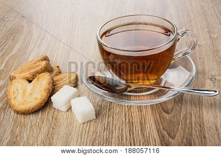 Puff Cookies, Transparent Cup With Tea, Lumpy Sugar And Spoon