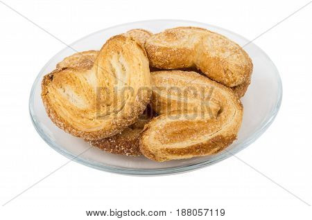 Puff Cookies In Form Heart In Transparent Saucer On White