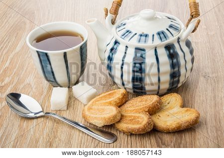 Puff Cookies, Striped Cup With Tea And Teapot, Lumpy Sugar