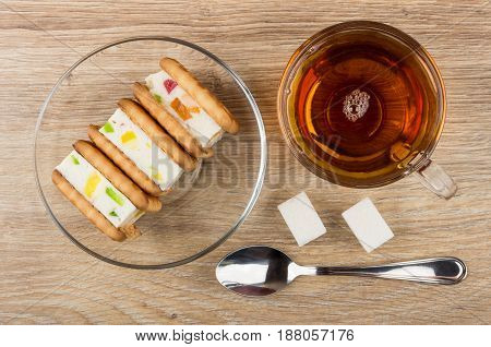 Cookies With Marshmallow On Saucer, Cup Of Tea, Lumpy Sugar