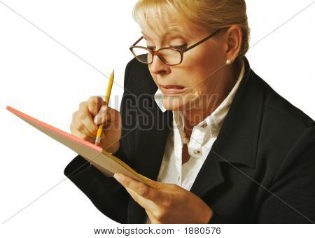 Female Erases Mistake On Notepad