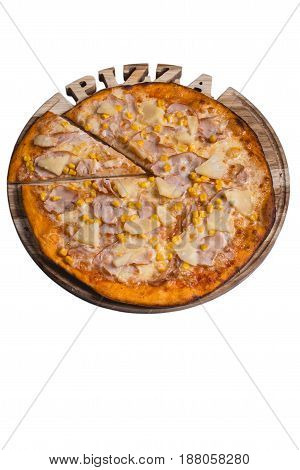 Italian pizza with ham pineapple and corn. A series of different types of pizza for menus photographed from one angle.