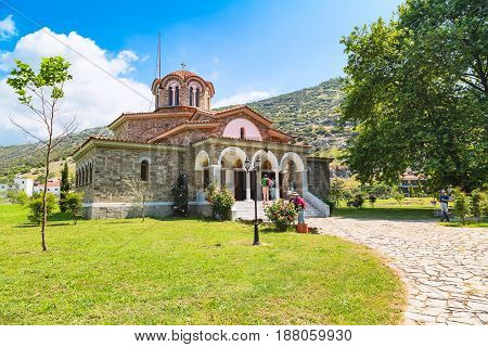 Philippi, Greece - April 30, 2016: St. Lydia, first European Christian, baptistry church, in Lydia and people near the entrance