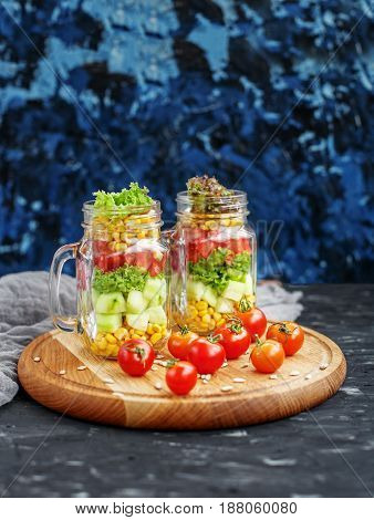 Vegetable salad with tomatoes and cucumbers and corn and lettuce. Healthy food Diet Detox Clean Eating or Vegetarian concept