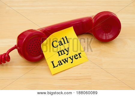 Remember to call your lawyer Retro red phone handset with a yellow sticky note and text Call my Lawyer