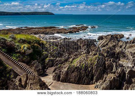 Rocky beach near the beach of Woolacombe. Sunny day. Summer. North Devon. England.