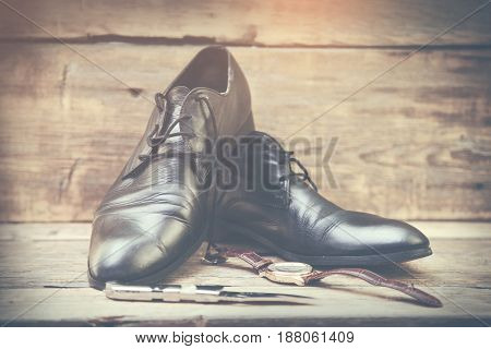 stylish men's watchesknifeblack dress shoes and notebook