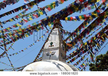 Swayambhu Swayambhunath Stupa Monkey Temple in Kathmandu, Nepal. Small Stupas and prayer flags lungta.