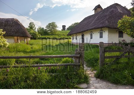 Old traditional Ukrainian house built in wattle and daub technique with thatched roof.