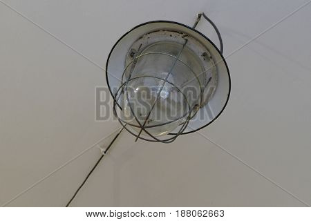 Old Round Industrial Light On A Ceiling