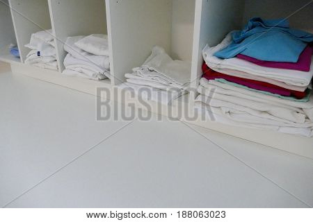 Ordinary Hospital Clothes Piled In A Shelf