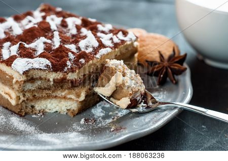 Tiramisu cake decorated with words Happy Birthday