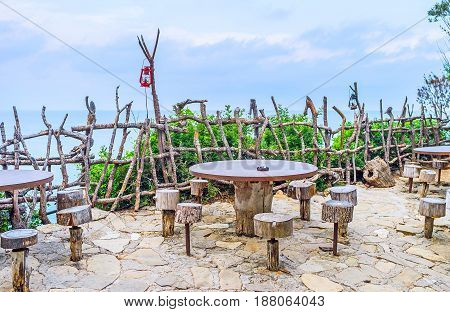 The open air terrace with the view on sea in rustic cafe of Yoruk park Kemer Turkey.