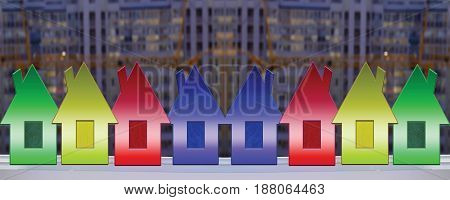 Colored houses in the background construction . The concept of the popularity of new housing .