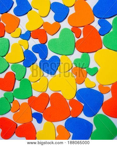 Heap of colorful candies confetti of heart shape abstract background Valentine Day holiday concept