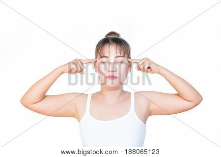 asian woman thinking and keeping her eyes closed