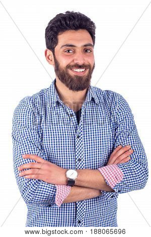 Portait of smiling beard young man wearing blue shirt isolated on white background