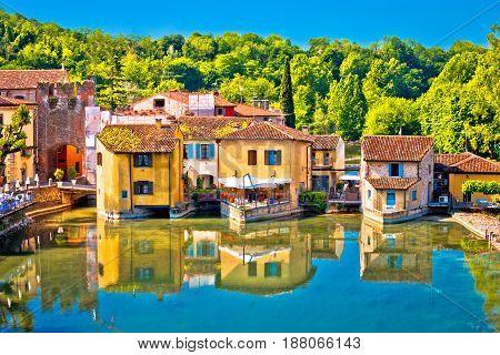 Mincio river and idyllic village of Borghetto view Veneto region of Italy poster