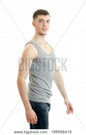 beautiful sporty young guy standing in a t-shirt and looking at camera isolated on white background