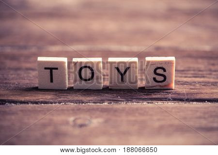 wooden elements with the letters collected in the word toys