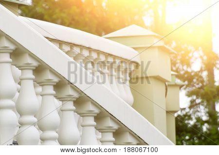 Decorative a stone railing staircase white light