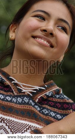Wondering Latina Female Wearing a Knit Sweater