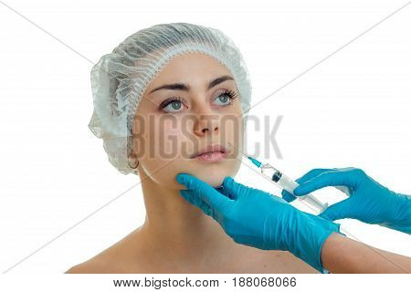 young girl at the plastic surgeon does prick isolated on white background