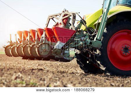 Farmer seeding crops at field closeup picture