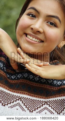Smiling Hispanic Girl Teenager Wearing a Knit Sweater