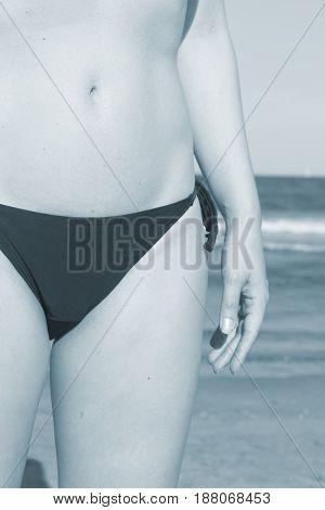 Young Lady In Bikini On Beach