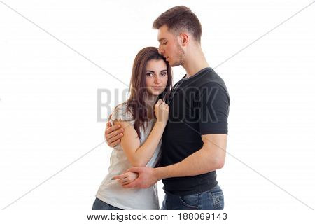 young couple hugging isolated on white background