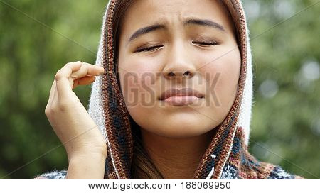 Teenager Female And Anxiety Wearing a Hooded Sweater