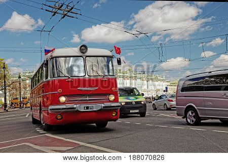 SAINT-PETERSBURG, RUSSIA - 21 MAY 2017: Parade of vintage cars. Old bus. Tinted photo.