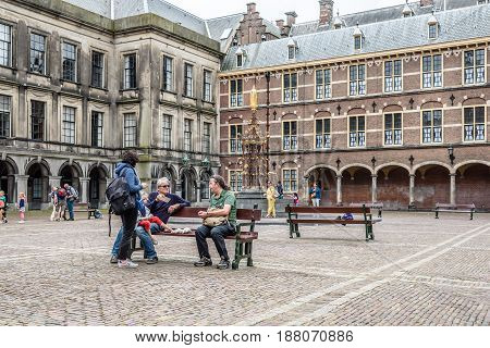 Hague Netherlands - August 7 2016: Unidentified people in the Inner court of Binnenhof. It is a complex of buildings in the city centre of The Hague. Includes the Office of the Prime Minister and House of Representatives.