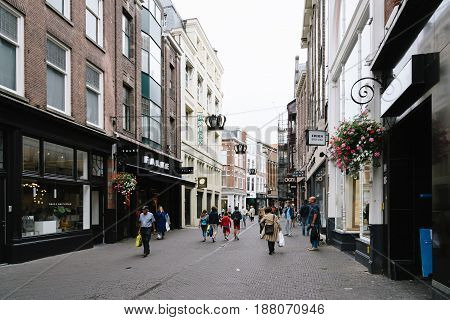 The Hague The Netherlands - August 7 2016: View of typical commercial street in the Hague a cloudy day of summer. The Hague is the seat of the Dutch government and multiple international organizations.