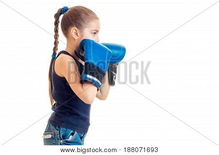 young girl on boxing practice isolated on white background